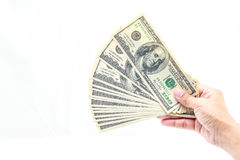 Hand holding one hundred dollars. Hold one hundred dollars in hand on white background Royalty Free Stock Images