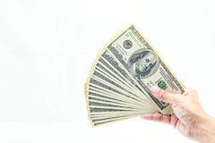 Hand holding one hundred dollars. Hold one hundred dollars in hand on white background Royalty Free Stock Photo