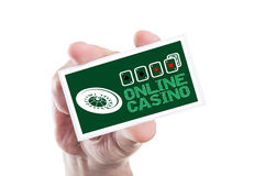Hand holding online casino card with roulette and four aces. As internet gambling website concept Stock Photo