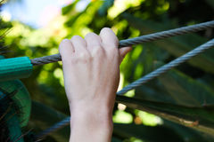 Hand holding onto a Wire cable Royalty Free Stock Images