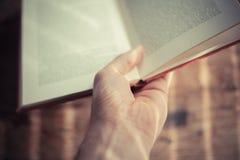 Hand holding open book Stock Photos