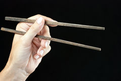 Hand Holding Open Chopsticks Royalty Free Stock Image