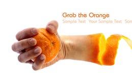 Hand holding an orange stock photo