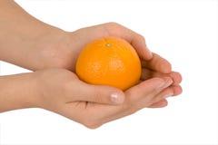 Hand holding orange Royalty Free Stock Images