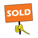 Hand holding orange board with sold message Stock Photography