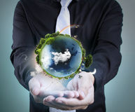 Hand holding our planet earth glowing. Earth image provided by Stock Photo