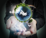 Hand holding our planet earth glowing. Earth image provided by Royalty Free Stock Image