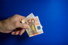 Hand holding out a banknote Stock Photos