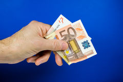 Hand holding out a banknote Royalty Free Stock Images
