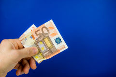 Hand holding out a banknote Royalty Free Stock Image