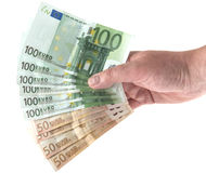 Hand holding out a fan of eurobill money Royalty Free Stock Photo