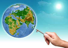The hand holding out the keys to the whole world. Royalty Free Stock Images
