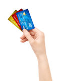 Hand holding pack of credit card isolated Royalty Free Stock Images