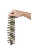 Hand holding pack of machine gun bullets Stock Photos