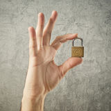 Hand holding padlock with Copyright symbol Stock Images