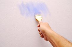 Hand holding a paint brush Stock Images