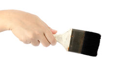 Hand holding paint brush Stock Images