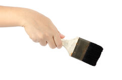 Hand holding paint brush Royalty Free Stock Photo