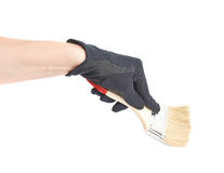 Hand holding a paint brush, isolated Royalty Free Stock Images
