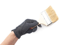 Hand holding a paint brush, isolated Stock Image