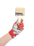 Hand holding a paint brush, isolated Stock Photo