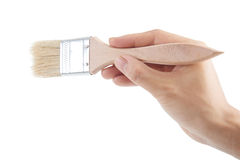 Hand holding a paint brush Royalty Free Stock Images