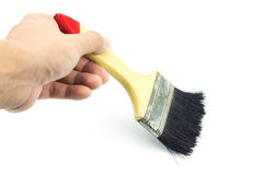 Hand holding paint brush on white background Stock Images