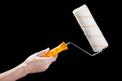 Hand holding paint roller Stock Photography
