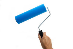 Hand holding paint roller Royalty Free Stock Image