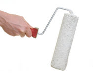 Hand holding paint roller Stock Photos