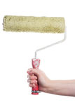 Hand holding paint roller Royalty Free Stock Images