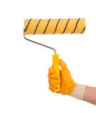 Hand holding a paint roller Royalty Free Stock Images