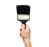 Hand holding  paintbrush isolated on white Royalty Free Stock Photography