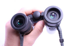 Hand holding pair of binoculars isolated on white Royalty Free Stock Photos