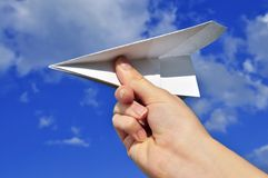 Hand holding paper airplane Stock Image