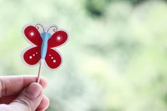 Hand holding paper butterfly royalty free stock photography