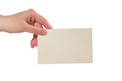 Hand holding a paper card Stock Image