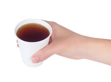 Hand holding paper cup of tea isolate. Hand holding white paper cup of tea isolated on white background. Woman holds a disposable cup over white background Royalty Free Stock Photography