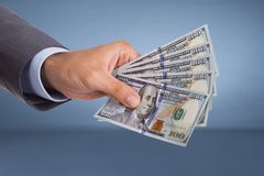 Hand holding paper currency Royalty Free Stock Image