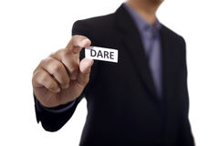 Hand Holding Paper With Dare Text Stock Image