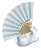 Hand holding paper fan Stock Photography