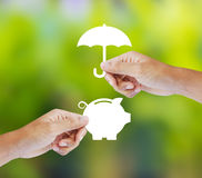 Hand holding a paper  piggy bank and umbrella Stock Images