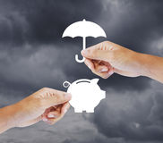 Hand holding a paper  piggy bank and umbrella. Insurance concept Stock Photography