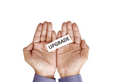 Hand Holding Paper With Upgrade Text Royalty Free Stock Photography