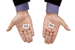 Hand Holding Paper With Yes No Text Stock Photos