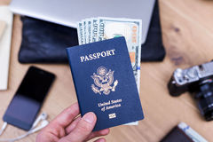Hand holding passport with dollars Stock Photography