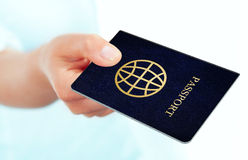 Hand holding passport over white background Royalty Free Stock Photos