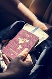 Hand holding passport and travel tickets. For holiday Royalty Free Stock Photography