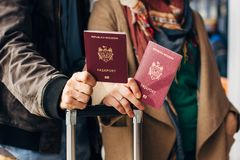 Couple Hand holding Passport . Traveler with Luggage Travel concept. People tourism. Biometric Moldavian passports Royalty Free Stock Photography