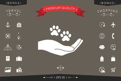Hand holding paw symbol. Animal protection. Signs and symbols - graphic elements for your design Royalty Free Stock Image